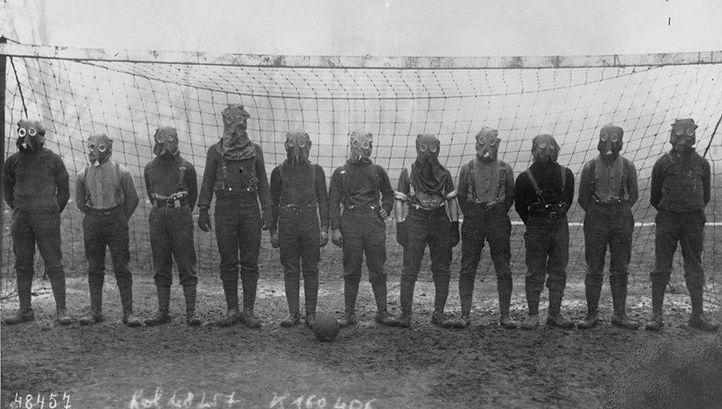 1916_soccer_team_of_british_soldiers_with_gas_masks_world_war_i_somewhere_in_northern_france.jpg