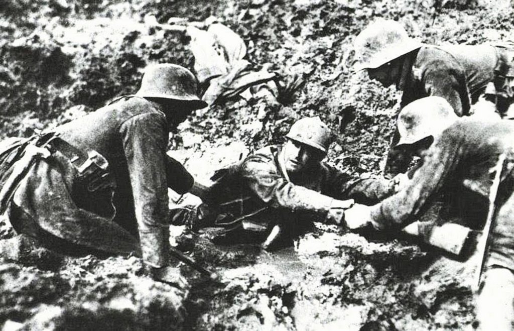 1918_german_troops_trying_to_rescue_a_french_soldier_from_sinking_in_a_mud_hole.jpg
