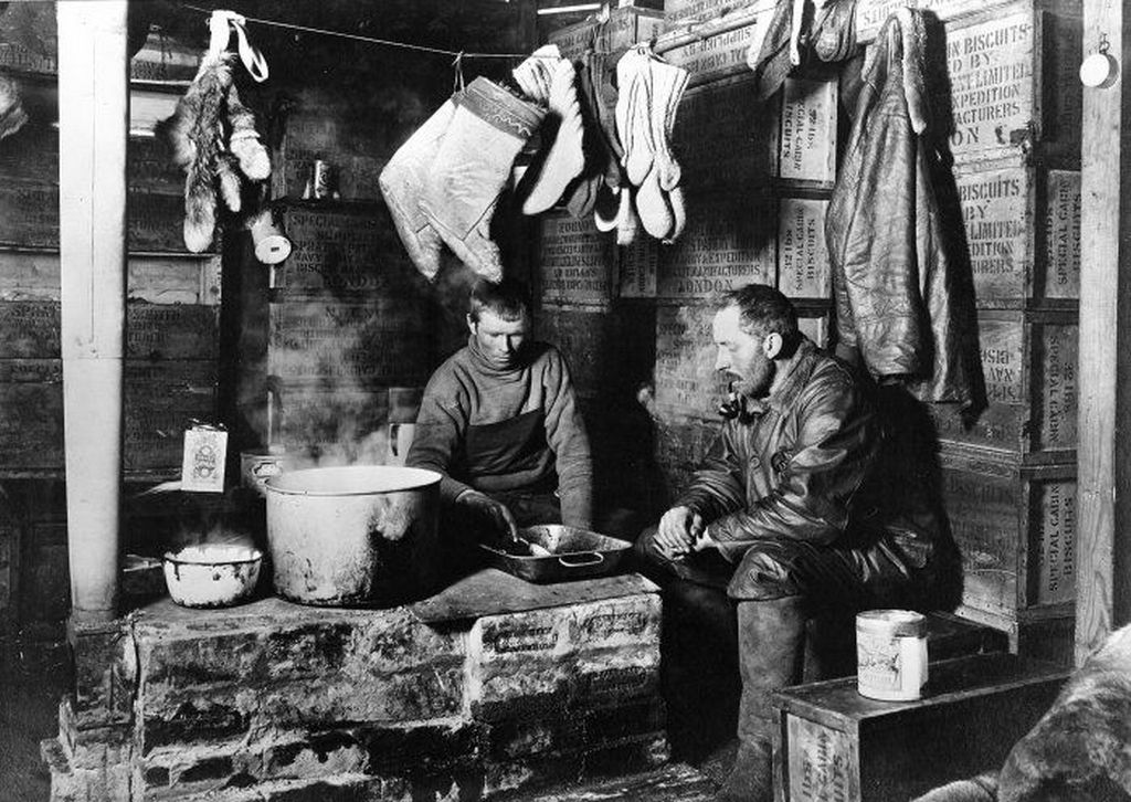 1911_cecil_meares_and_dimitri_girev_at_the_blubber_stove_in_the_scott_s_discovery_hut_at_hut_point_november_3_1911.jpeg