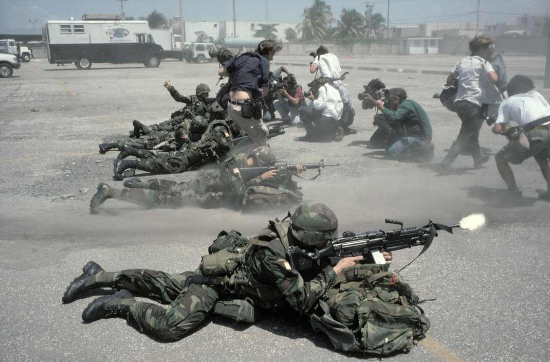 1994_photographers_scramble_in_front_of_us_troops_during_the_1994_invasion_of_haiti.jpg