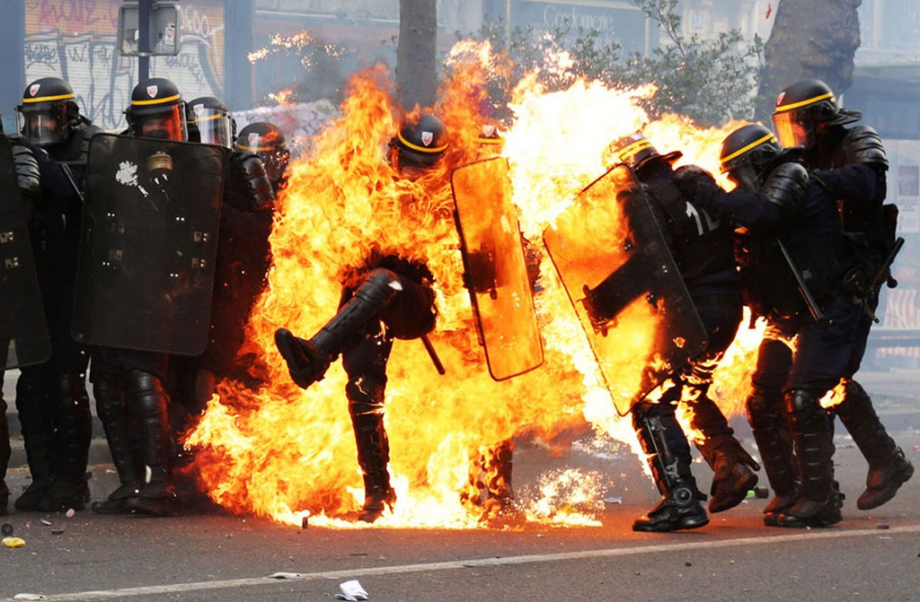 2017_05_01_french_crs_riot_police_officers_are_engulfed_in_flames_as_they_face_protesters_during_a_march_for_the_annual_may_day_workers_s_rally_in_paris.jpg