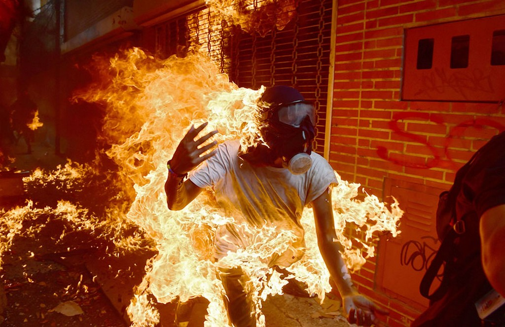 2017_05_03_a_demonstrator_catches_fire_during_clashes_with_riot_police_during_a_protest_against_venezuelan_president_nicolas_maduro_in_caracas.jpg