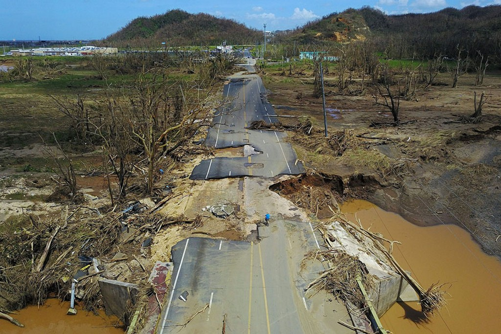 2017_09_28_after_the_passage_of_hurricane_maria_a_man_rides_his_bicycle_on_a_storm-damaged_road_in_toa_alta_west_of_san_juan_puerto_rico.jpg