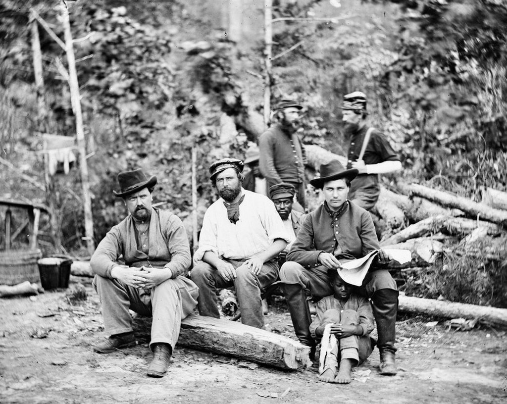 1862_union_soldiers_posing_with_a_escaped_slave_child_in_new_kent_county_virginia.jpg