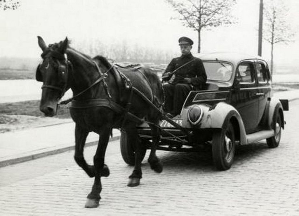 1941_during_the_german_occupation_of_the_netherlands_people_still_used_a_car_without_fuel_because_of_shortages_in_this_picture_a_ford_v_is_drawn_by_a_horse.jpg