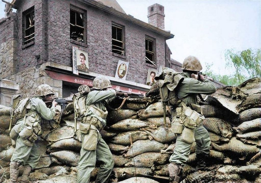 1950_u_s_marines_shoots_north_korean_troops_from_behind_a_barricade_during_the_battle_of_seoul.jpg