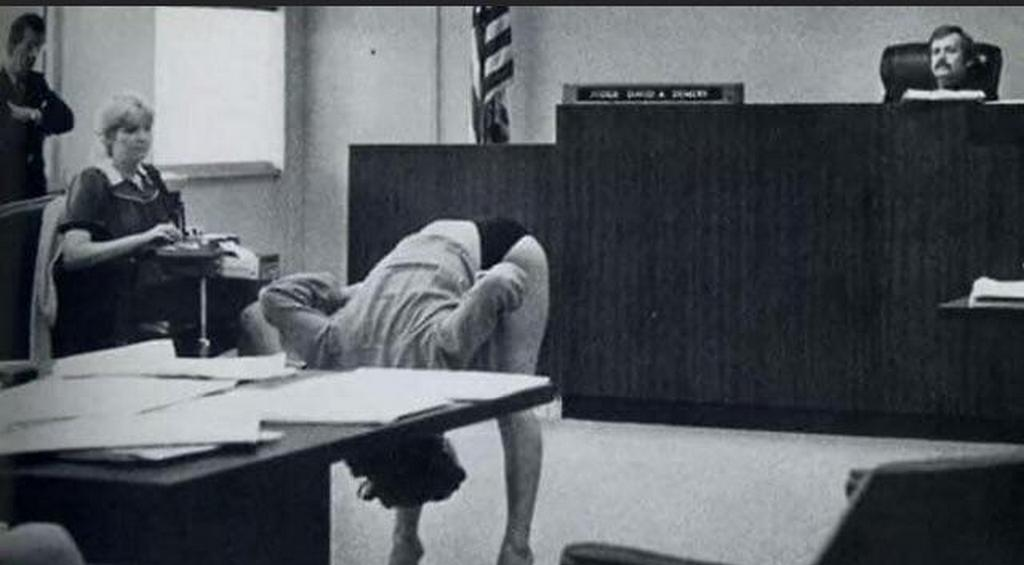 1983_stripper_in_fla_showing_judge_that_her_panties_covered_her_genitalia_and_that_she_wasn_t_guilty_of_exposing_herself_to_the_police_that_arrested_her.jpg