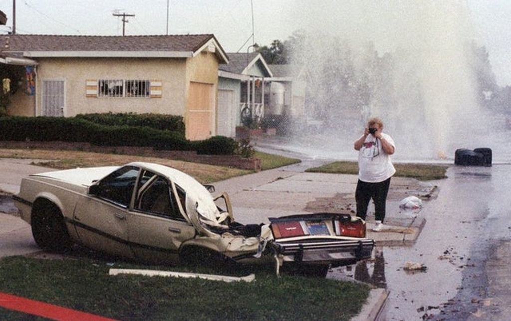 1995_jeanie_basurto_photographs_her_crushed_car_after_shawn_nelson_drove_a_tank_through_clairemont.jpg