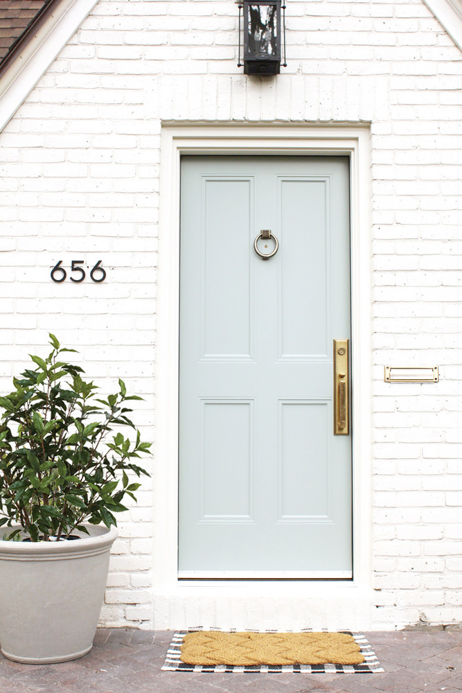 a-1930s-fixer-upper-gets-a-much-needed-makeover-studio-mcgee-front-door-58f7c3db40a5bb2033934929-w1000_h1000.jpg