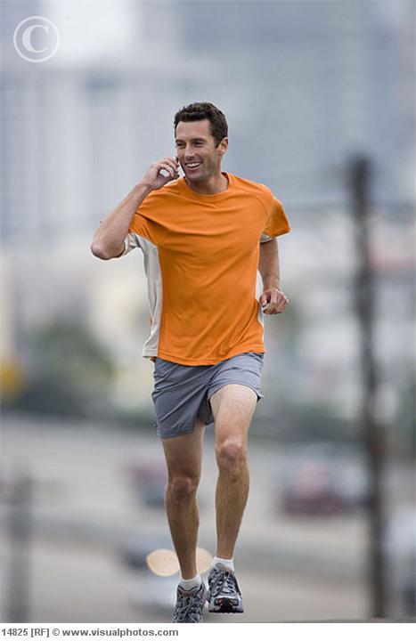 man_running_outdoors_using_mobile_phone_14825.jpg