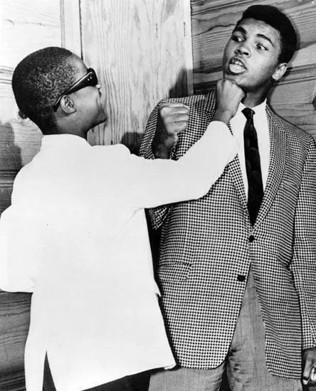 13_year_old_stevie_wonder_goofing_around_with_muhammad_ali_at_the_apollo_harlem_1963.jpg