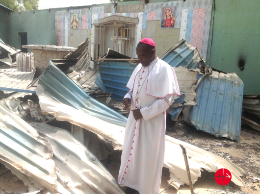 dscnigeria_bishop-oliver-dashe-doeme-in-the-remains-of-a-catholic-church-in-bahuli_530.jpg