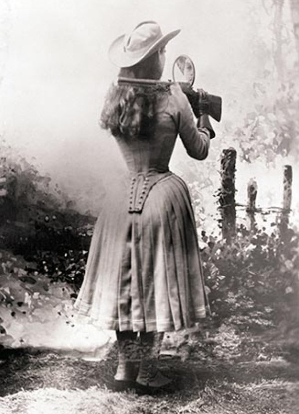 annieoakley-shooting-over-shoulder.jpg