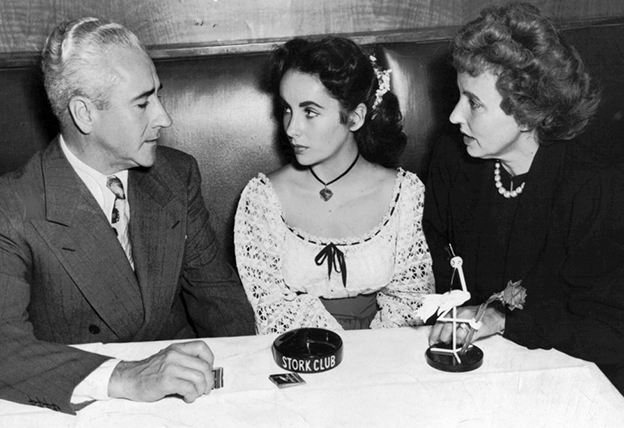 elizabeth_taylor_with_parents_at_stork_club_1947_pd.jpg
