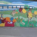 160 négyzetméteres festmény Kelenföldön. Iskolások töltötték meg élettel a vasúti aluljáró szürke falait