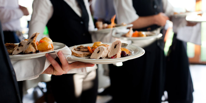 bigstock-waiters-carrying-plates-with-m-95742863-660x330.jpg