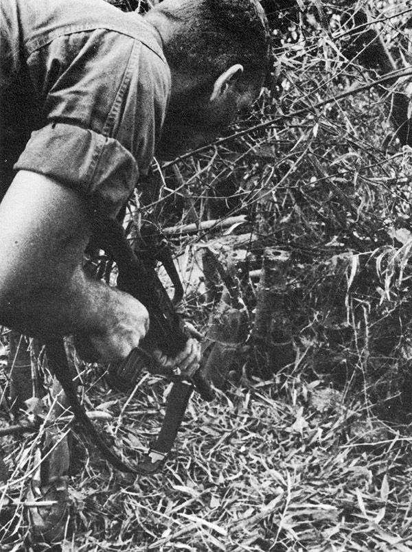 25th_inf_soldier_at_a_tunnel_breathing_tube.jpg