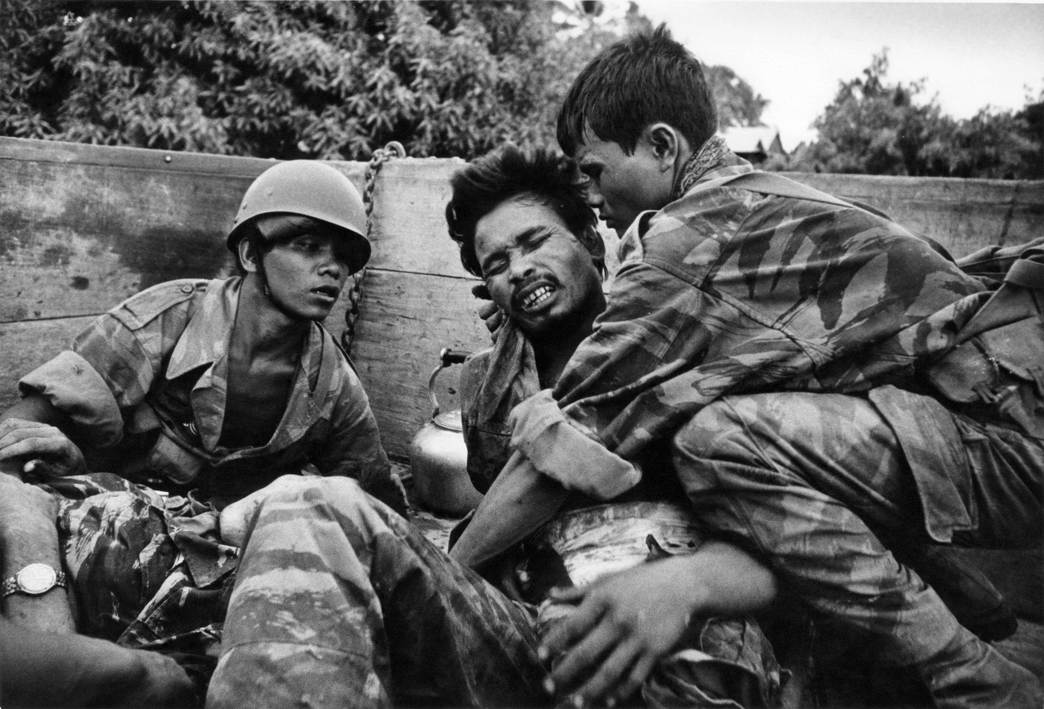 don_mccullin_on_truck_cambodia.jpg