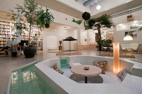 circle-round-lounge-area-with-water-features-luxury-unique-studio-apartment-remodeling-design.jpg