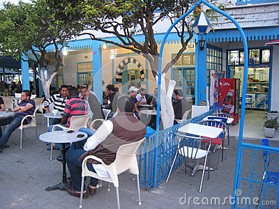 men-chatting-drinking-coffee-shop-sidi-bou-said-tunisia-30200124.jpg