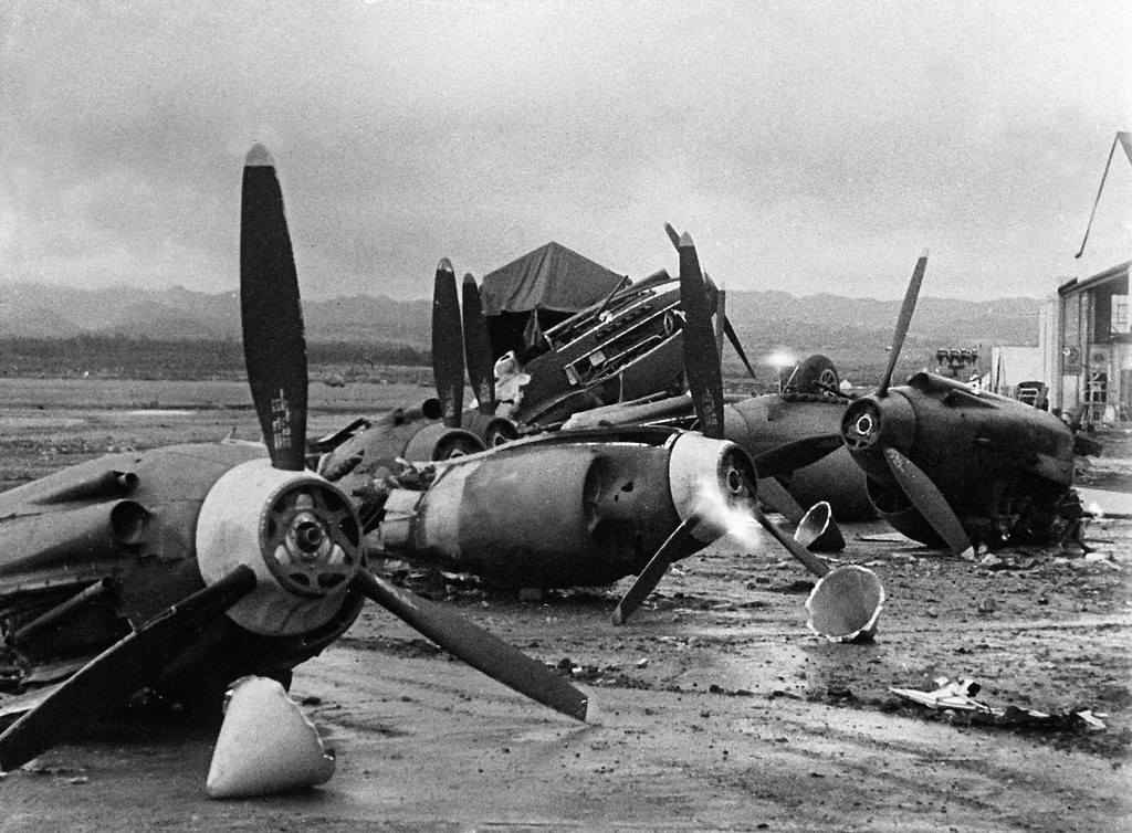 the_shattered_wreckage_of_american_planes_bombed_by_the_japanese_in_their_attack_on_pearl_harbor_is_strewn_on_hickam_field_dec_7_1941.jpg