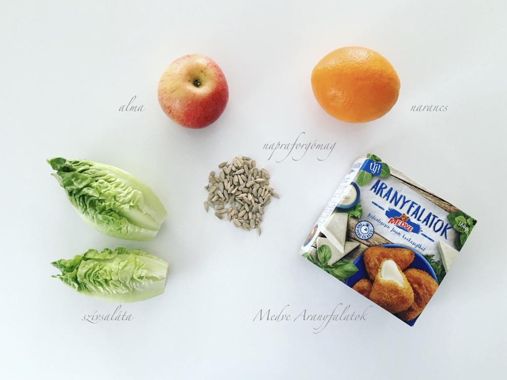 Az 5 hozzávaló: Medve Aranyfalatok, napraforgómag, narancs, alma, szívsaláta