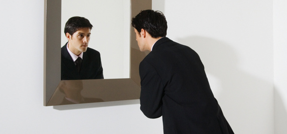 businessman-looking-in-mirror-pan_12170.jpg