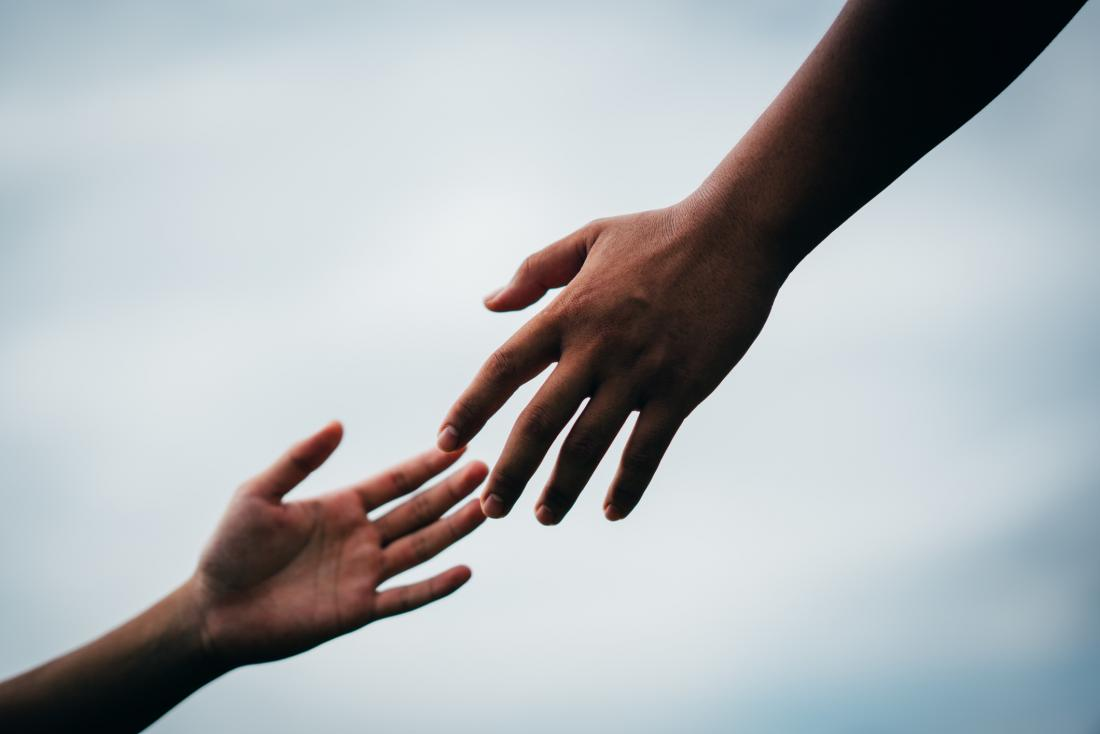 image-of-hand-reaching-to-hold-another-hand.jpg