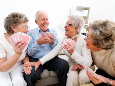 istockphoto_9976075-happy-senior-men-and-women-playing-cards_1.jpg