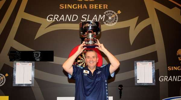 phil-taylor-singha-beer-grand-slam-of-darts-champion-lawrence-lustig-pdc_a3kvwpbjjw8m13ni1l8svil1v.jpg