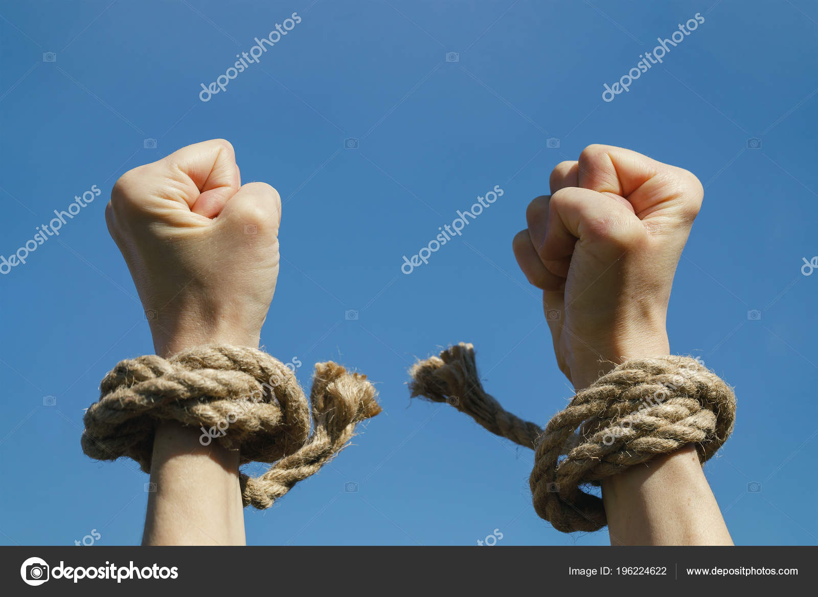 depositphotos_196224622-stock-photo-hands-free-shackles-stretched-blue.jpg