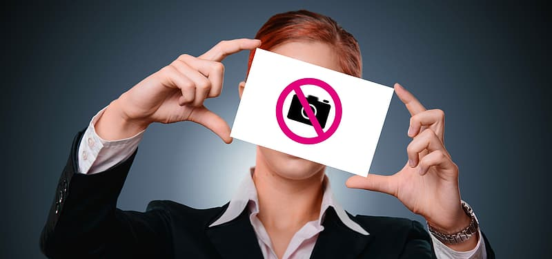 woman-holding-no-camera-allowed-poster_1.jpg