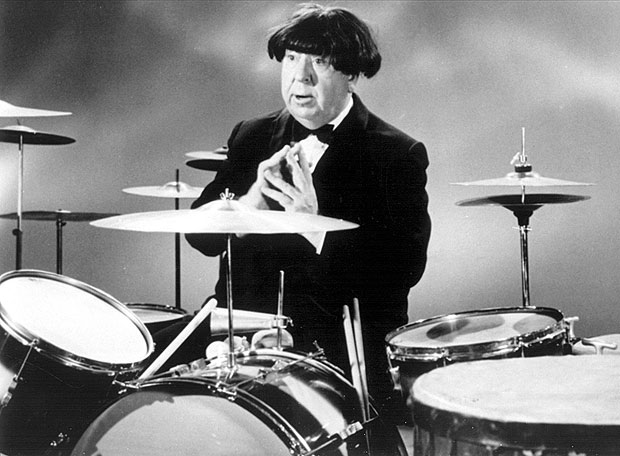 Alfred Hitchcock wearing a Beatle wig, 1964.jpg