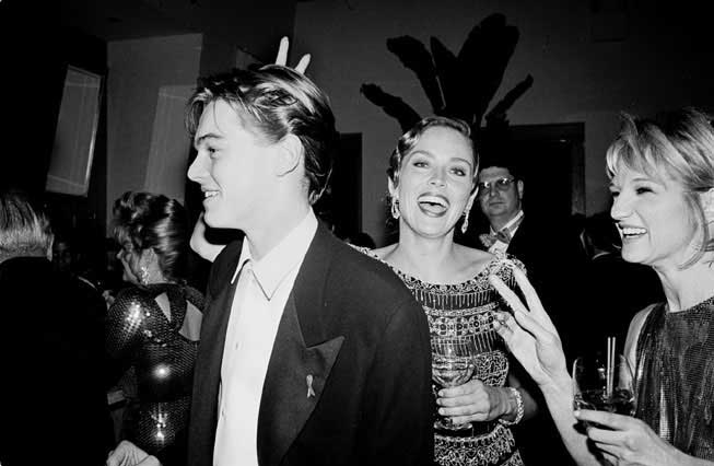 Sharon-Stone-and-Ellen-Barkin-teasing-a-19-year-old-Leonardo-DiCaprio-at-Vanity-Fair's-first-annual-Oscar-party.jpg