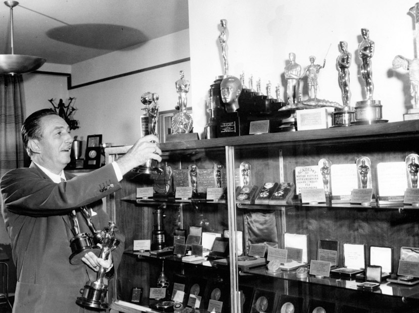 walt-disney-with-all-his-awards-oscars.jpg