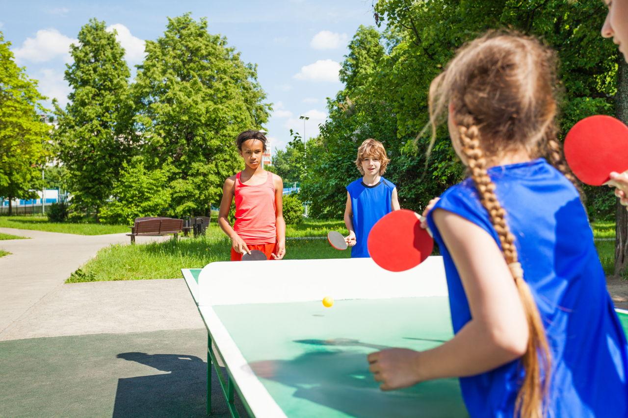 1280-484676590-four-international-friends-play-table-tennis.jpg