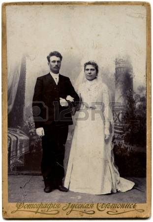 14541848-russia--circa-end-of-the-xix--the-beginning-of-xx-century-an-antique-photo-shows-bride-and-groom-the.jpg