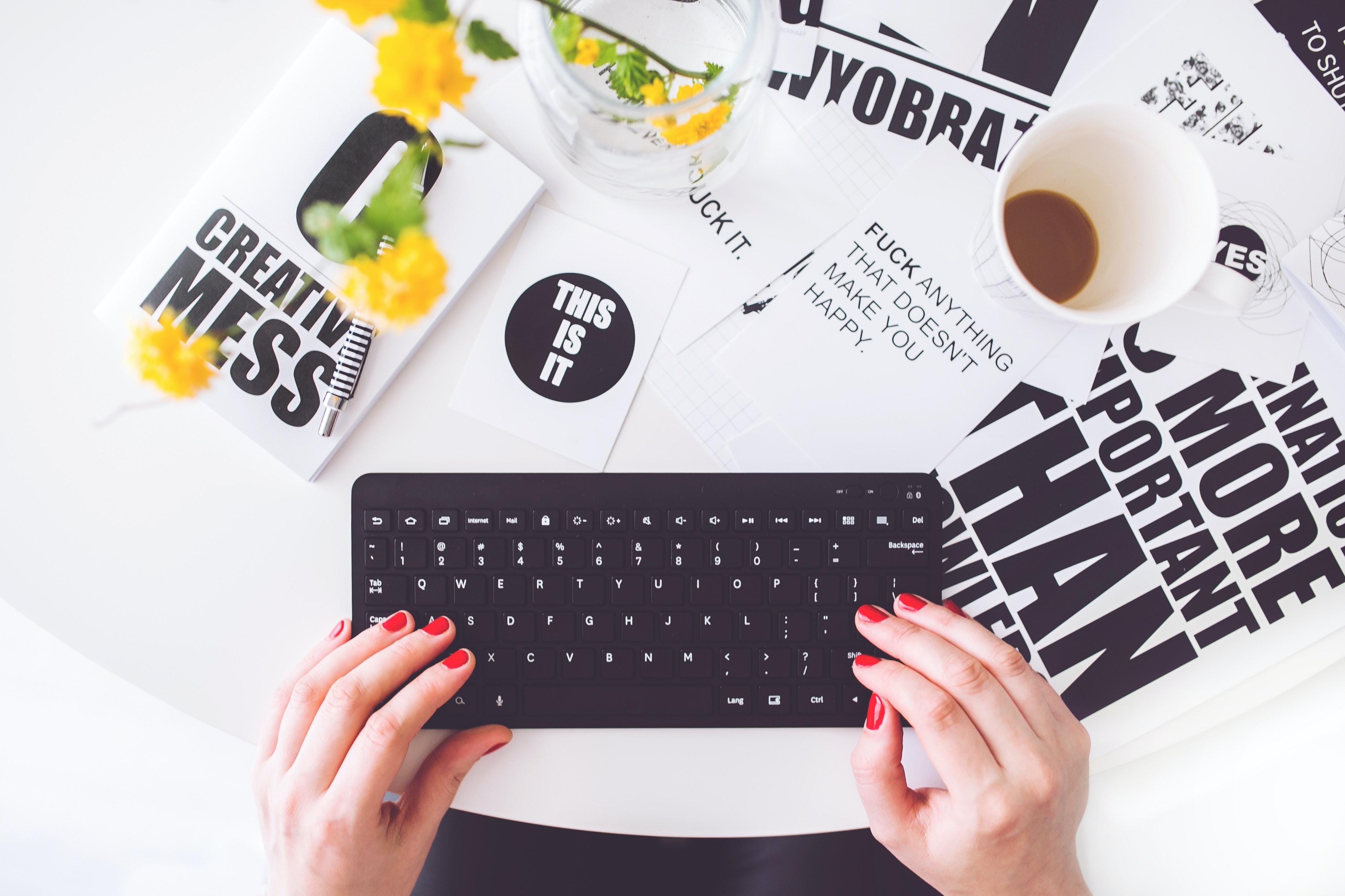 girl-writing-on-a-black-keyboard-6469.jpg