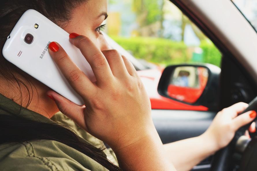 person-woman-smartphone-car-large.jpg
