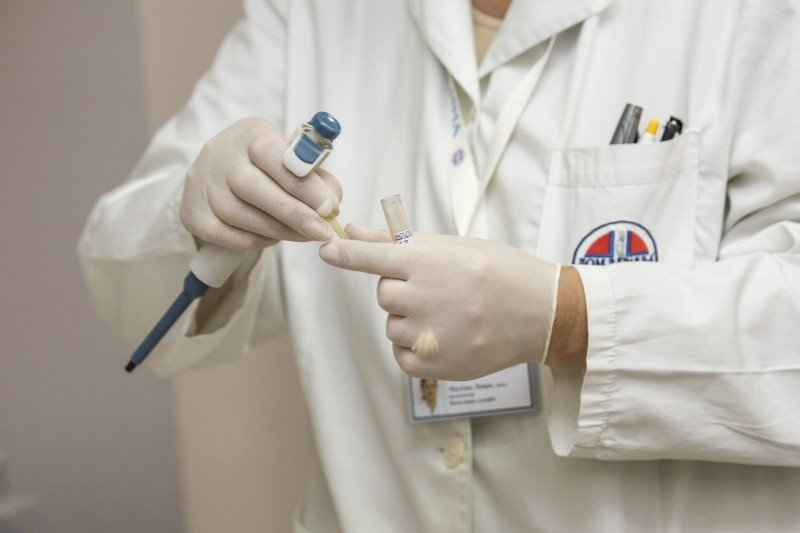 doctor-holding-test-tube-in-medical-lab.jpg