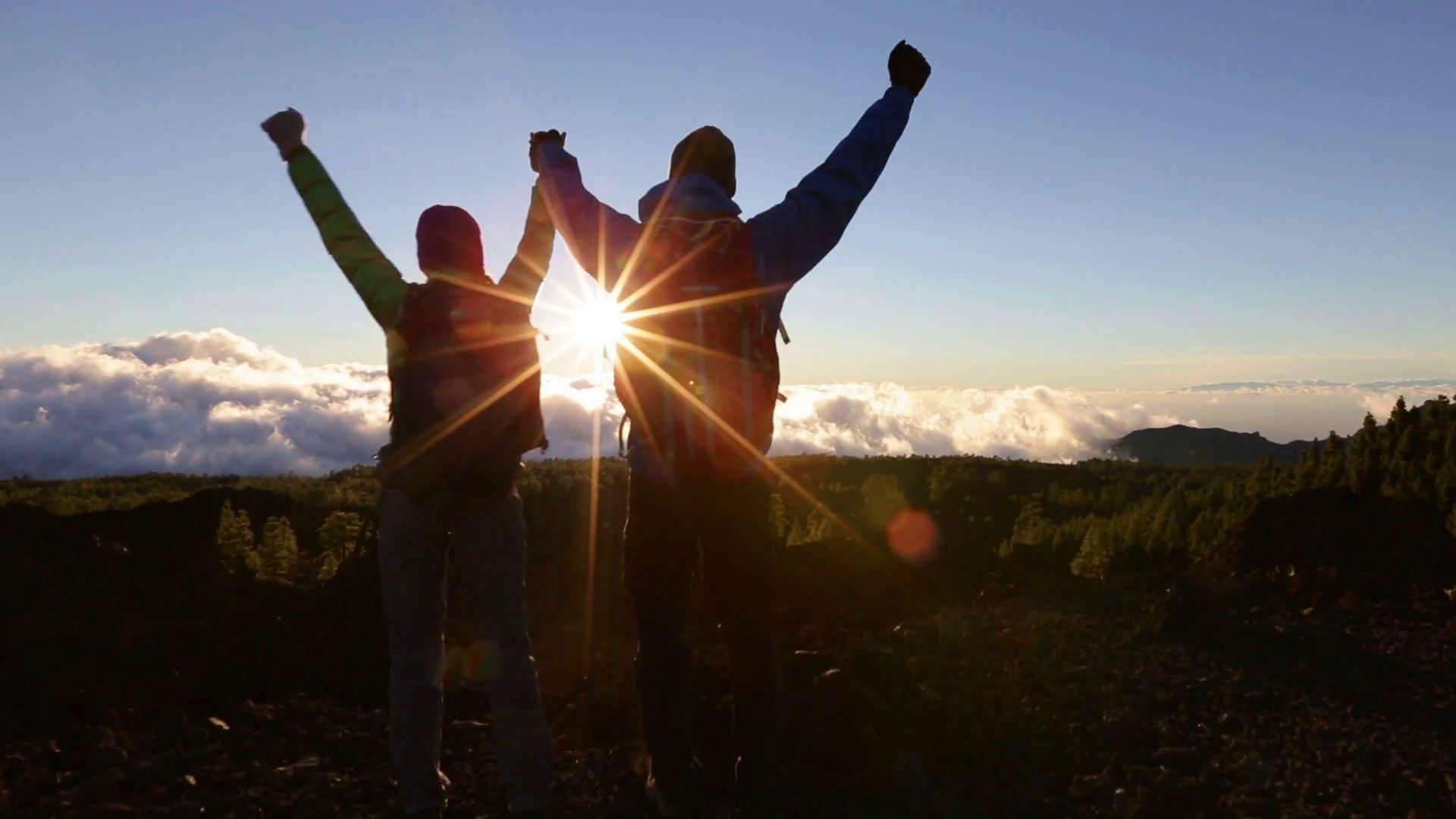 videoblocks-success-achievement-and-accomplishment-concept-with-hiking-people-cheering-jumping-running-and-celebrating-of-joy-on-trekking-hike-outside-hikers-having-fun-at-sunset_sfjisfo1_thumbnail-full06.png