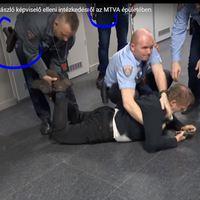 Fegyveres őrök verik Varjú László képviselőt
