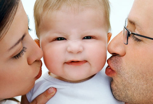 getty_rf_photo_of_parents_kissing_infant.jpg