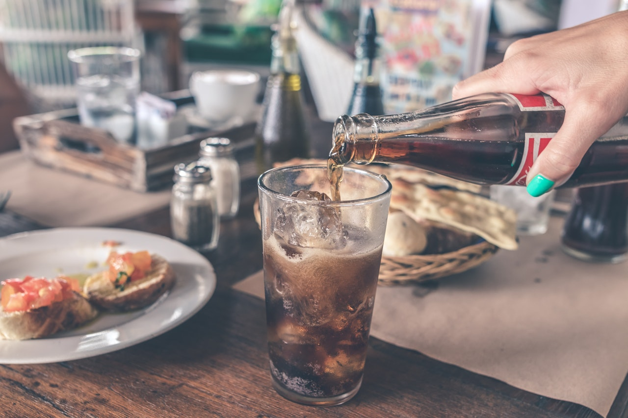 photo-of-cola-pouring-into-a-glass-with-ice-cubes-926569_1.jpg