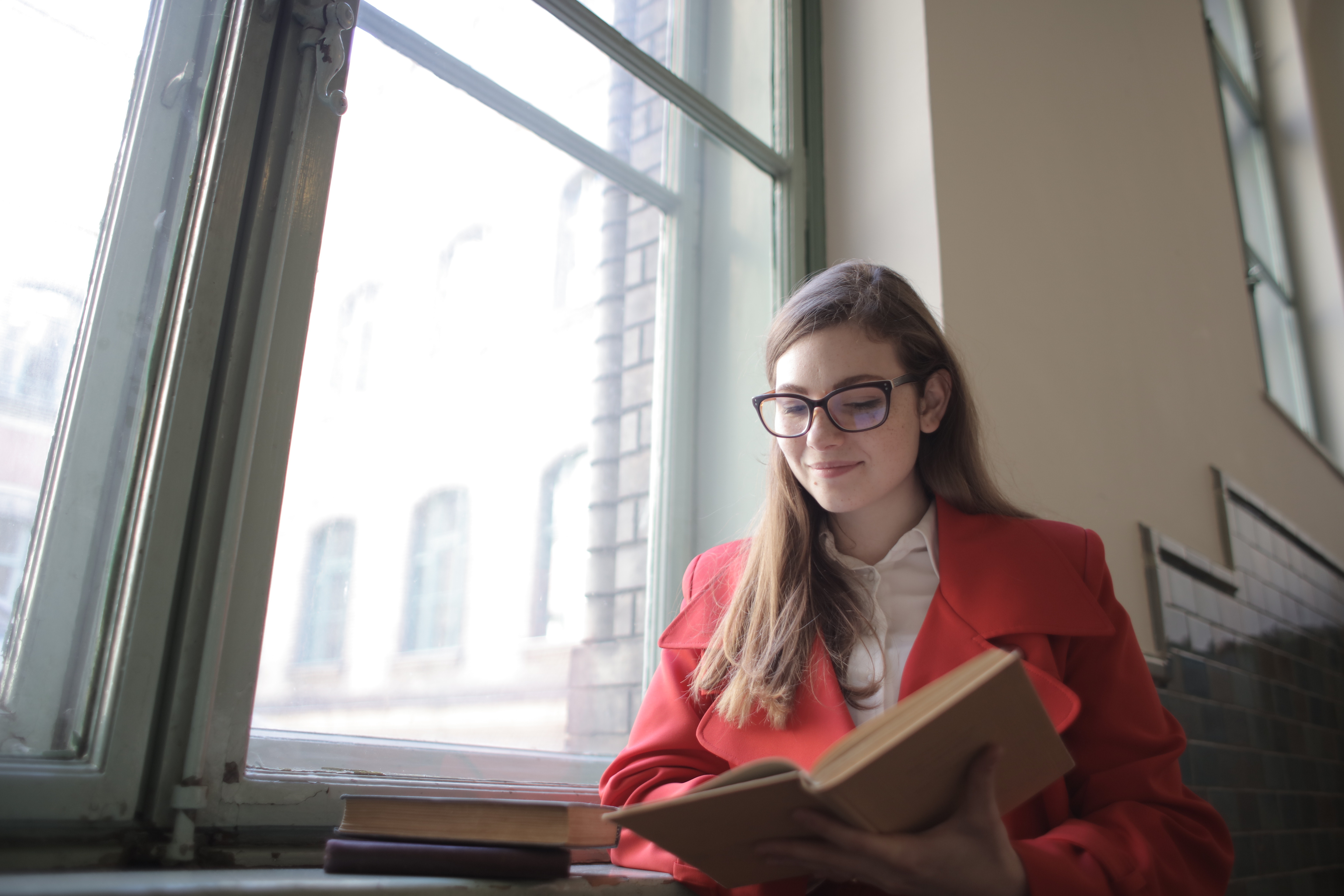 woman-in-red-blazer-reading-book-3791687.jpg