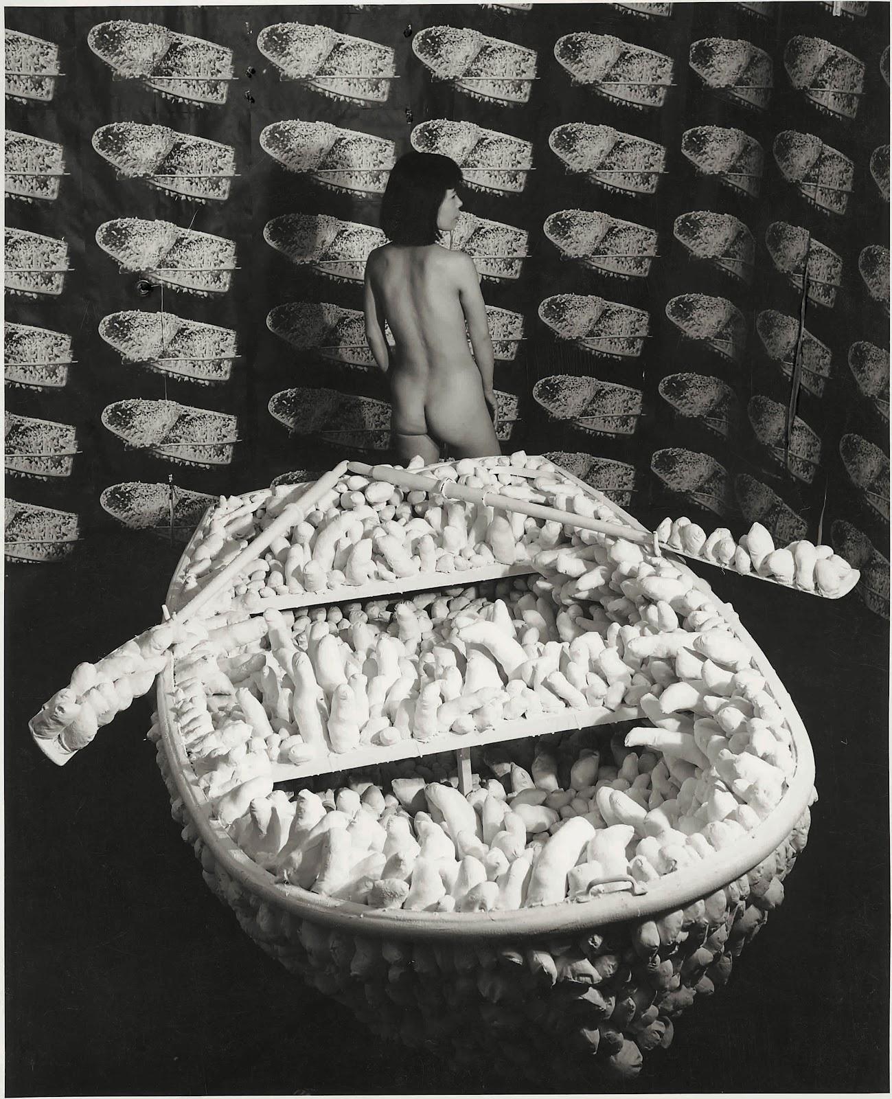 Yayoi Kusama Kusama posing in Aggregation- One Thousand Boats Show 1963 installation view, Gertrude Stein Gallery, New York 1963 © Yayoi Kusama and © Yayoi Kusama Studios Inc.jpg