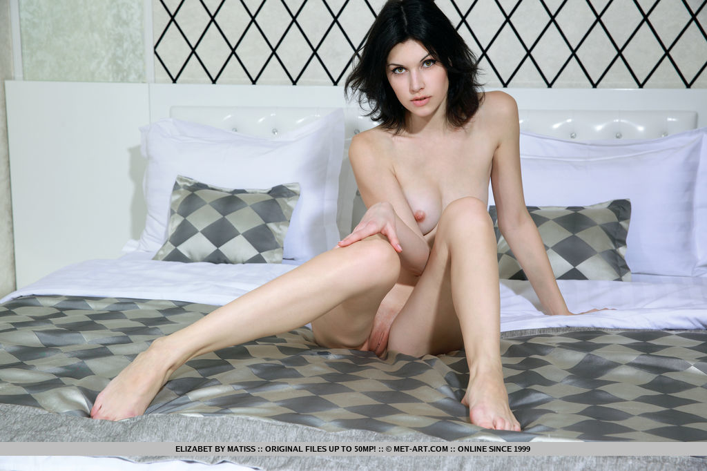 delicious-elizabet-strips-to-expose-her-juicy-shaved-pussy-13.jpg