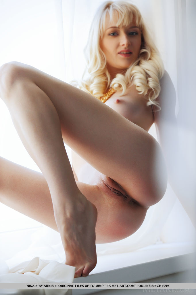 lonely-blonde-nika-n-gets-naked-in-front-of-camera-11.jpg