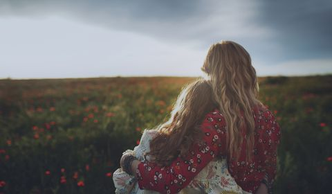 mother-and-daughter-hugging-in-poppy-field-high-res-stock-photography-951218804-1554481414.jpg