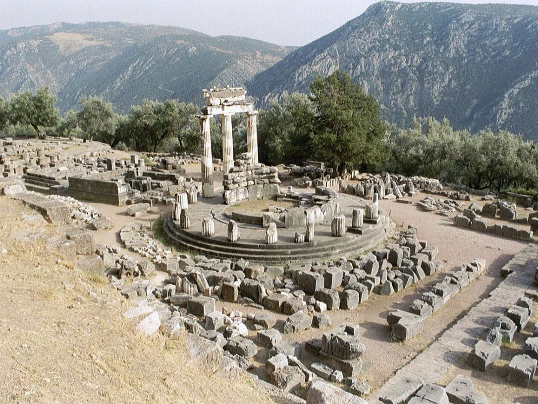 the_delphic_tholos_a_circular_building_that_was_constructed_between_380_and_360_bc_at_delphi_greece_the_mountain_town_thought_to_be_the_navel_of_the_world.jpg
